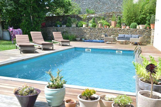 """20% offerts en bon d'achat pour l'achat d'une piscine bois<span class=""""normal italic petit"""">© Piscine bois braga, Jardimagine</span>"""