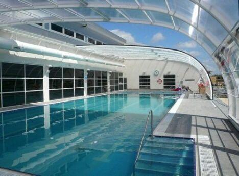"Abri de piscine banne Arqualand<span class=""normal italic petit"">© Arqualand</span>"