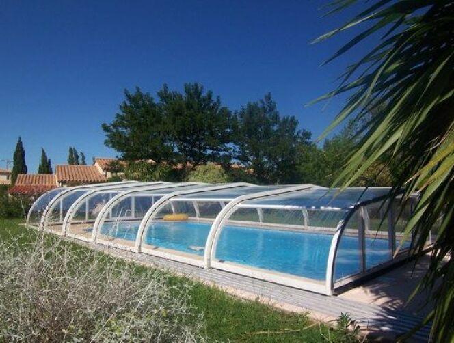 Galerie photos d 39 abris de piscine bas abri de piscine en for Piscine aluminium