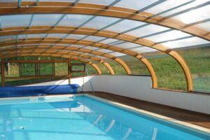 Abri de piscine haut fixe sur muret