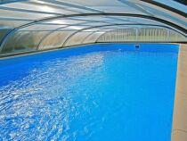 Un abri de piscine mi-haut pas cher