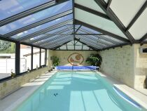 L'abri de piscine mural