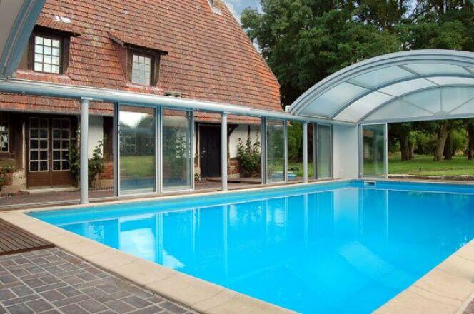 Reportage photos abris et couverture de piscine for Abri de piscine pop up
