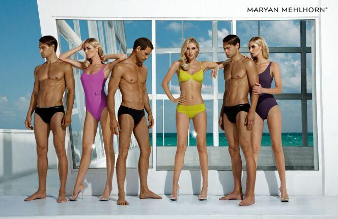 Collection Softline : slip de bain noir pour l'homme et maillot de bain uni pour la femme.