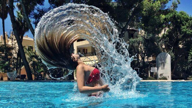 """Comment protéger ses cheveux colorés à la piscine ? <span class=""""normal italic petit"""">© schlitzer1 - Fotolia.com</span>"""