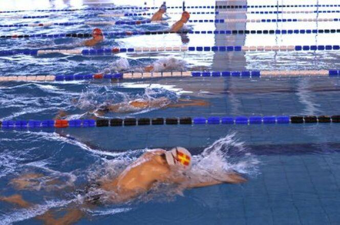 "Compétition de natation <span class=""normal italic petit"">© Tony - Fotolia.com</span>"