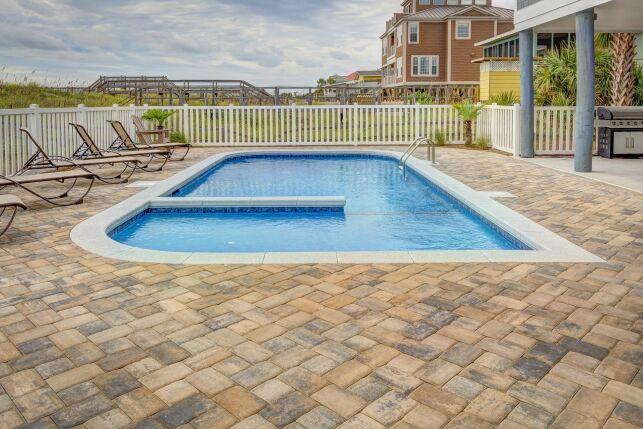 Distance d'implantation entre une piscine et le terrain d'un voisin