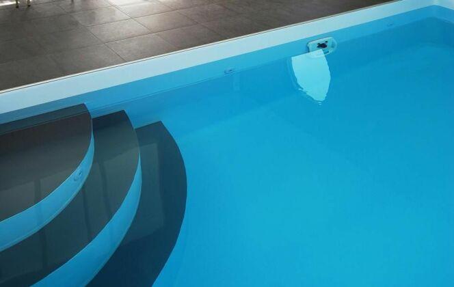 Escalier d'angle par l'Esprit Piscine © L'Esprit piscine