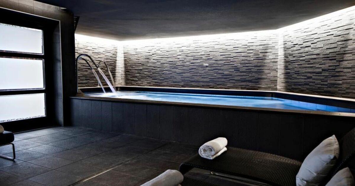 10 h tels avec spa de montagne et station de ski for Hotel megeve avec piscine interieure