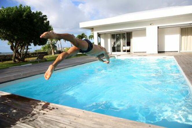 """Installer une piscine pour faire du sport chez soi<span class=""""normal italic petit"""">© goodluz - Fotolia.com</span>"""