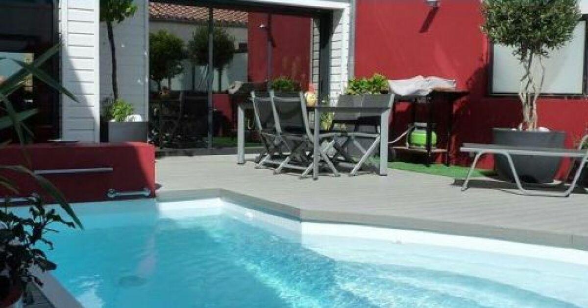 La piscine citadine forme libre for Piscine miroir forme libre