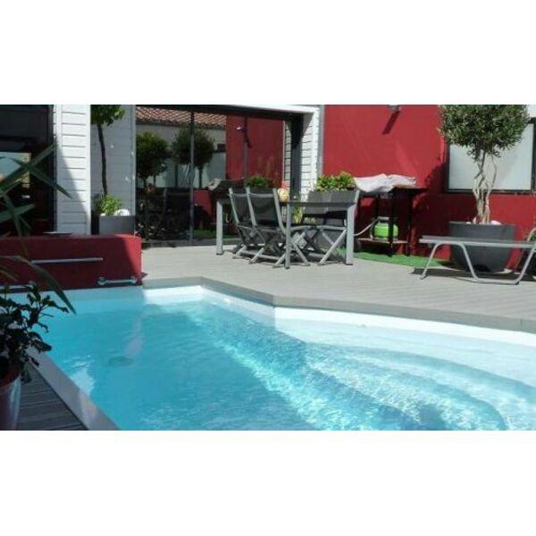 la piscine citadine forme libre piscine enterr e l. Black Bedroom Furniture Sets. Home Design Ideas