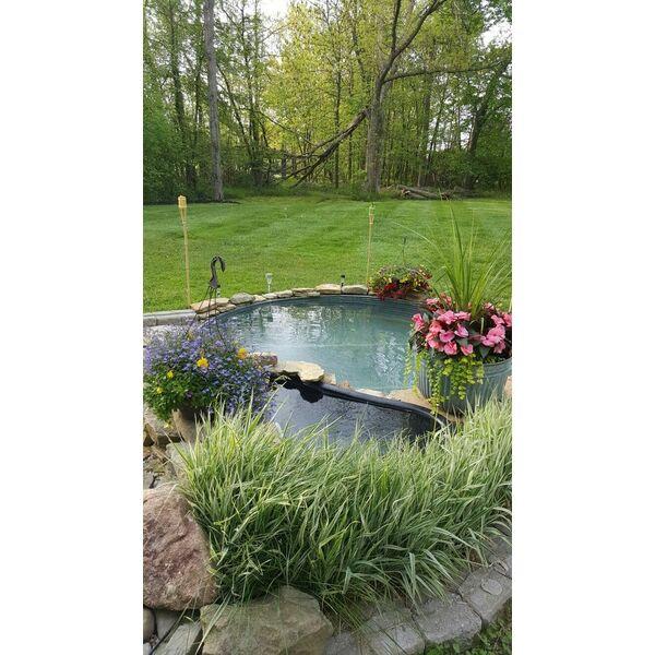 La piscine hors sol revisit e dans des cuves en m tal for Vider une piscine hors sol