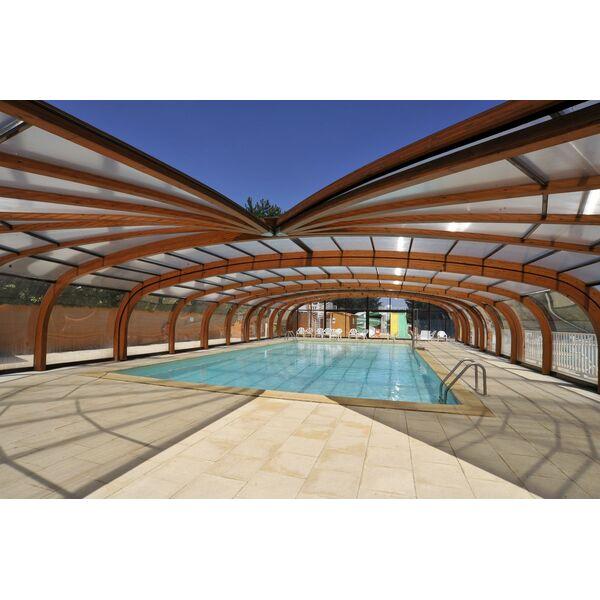 Le prix d 39 un abri de piscine en bois en accord avec ses for Abris de piscine occasion