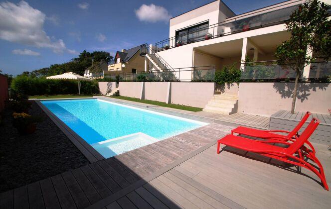 Maison et piscine design © L'Esprit Piscine