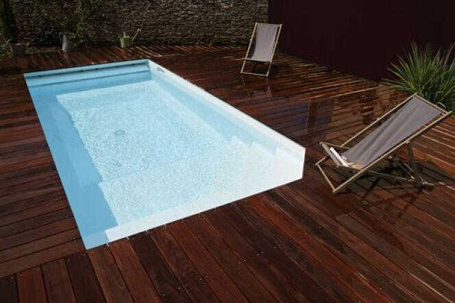 prix d une piscine caron la piscine nouveau centre de gravit de la famille with prix d une. Black Bedroom Furniture Sets. Home Design Ideas