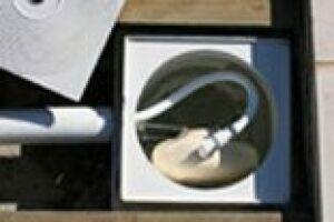 Régulateur de niveau NivOmatic installé dans un skimmer