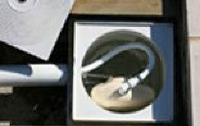 Régulateur de niveau NivOmatic installé dans un skimmer DR