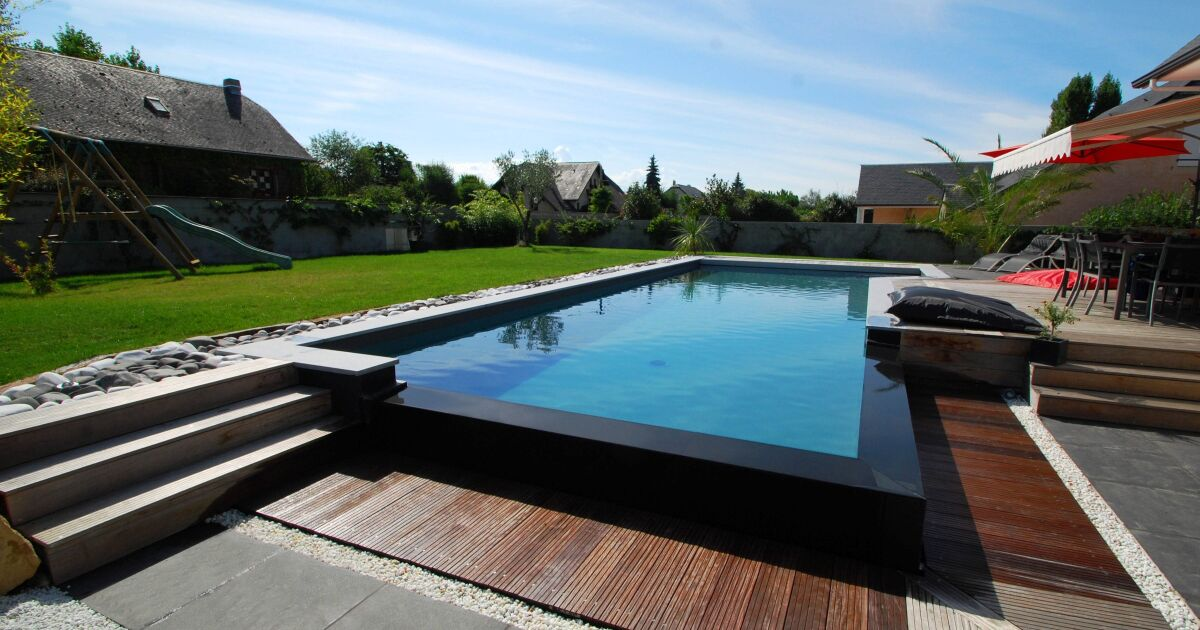 Les plus belles piscines tendances et modernes en photos piscine d bordement photo 5 for Jardin et piscine design