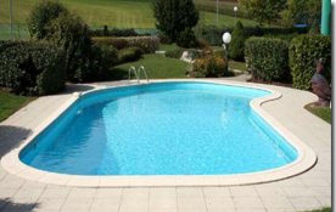 piscine béton terrasse bois oceania bois  © oceania