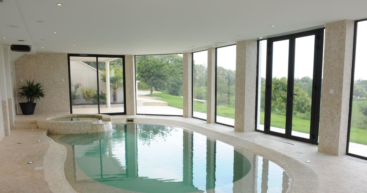 Les plus belles photos de piscines int rieures avec baie for Piscine miroir avec plage