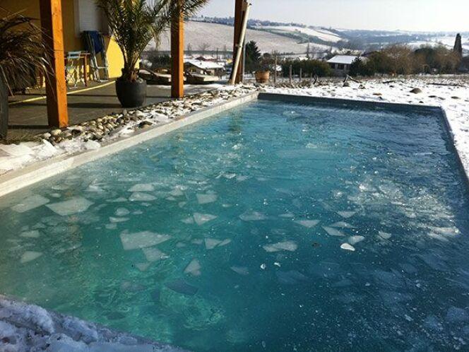 Reportage photos piscines sous la neige les plus belles for Piscine miroir beton
