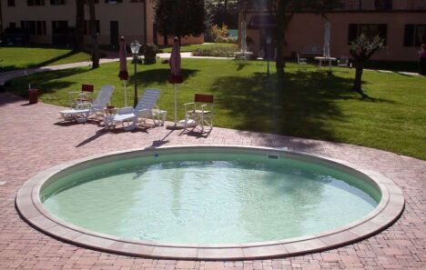 "Piscine ""Rosalie"" ronde avec liner Toscane<span class=""normal italic petit"">© Waterair</span>"