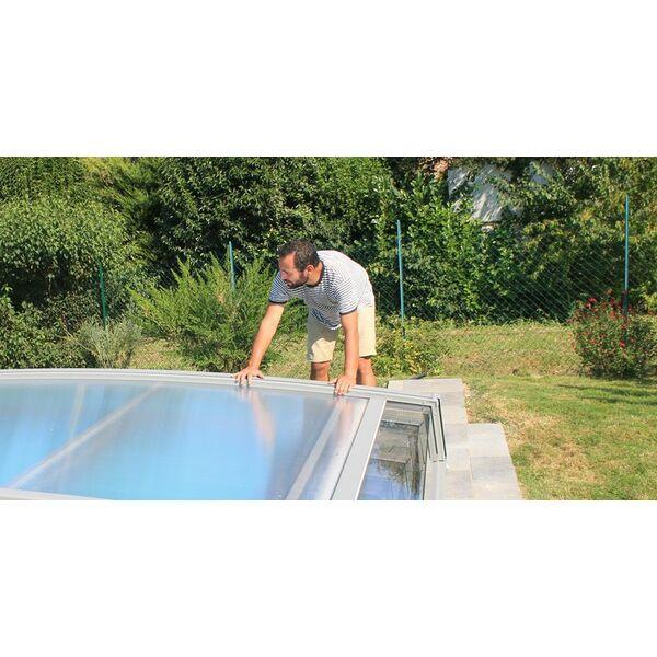 Pose d un abri de piscine les tapes for Pose de piscine