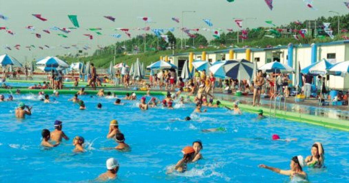 R ussir nager dans une piscine bond e for Piscine publique