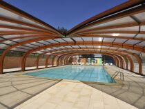 Les abris de piscine en bois lamellé collé