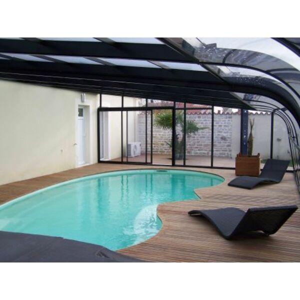 Un abri de piscine haut ou une v randa for Veranda pour piscine