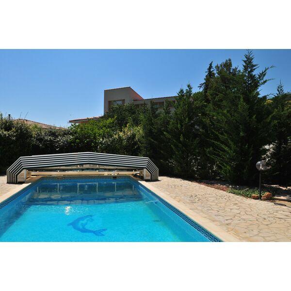 L abri de piscine plat sans rail au sol for Abri de piscine sans rail au sol
