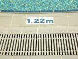 Un caniveau autour de votre piscine : évacuer l'eau de votre piscine