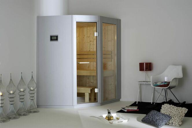 Une cabine de sauna deux places en angle sera facile à intégrer dans votre intérieur.