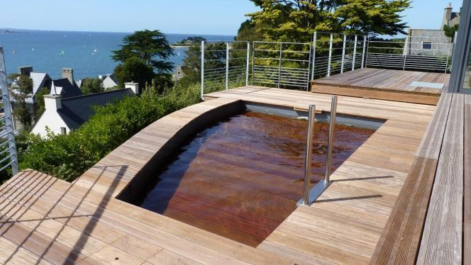 "Une piscine à fond mobile signée L'Esprit Piscine<span class=""normal italic petit"">© L'Esprit Piscine</span>"
