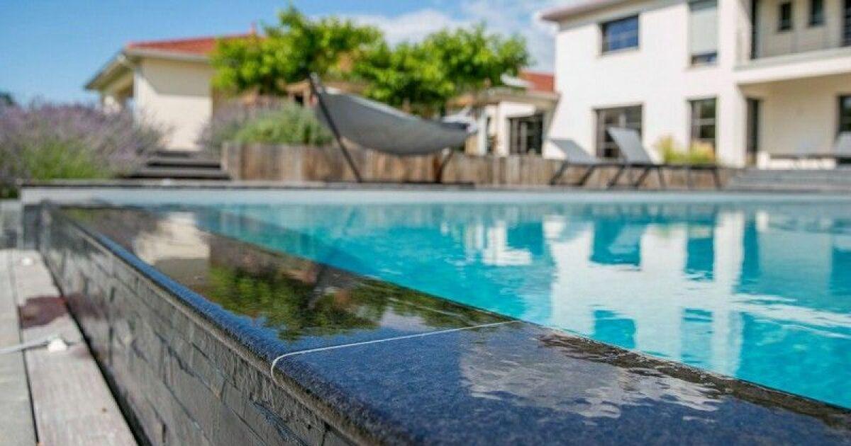 Une piscine en pierre atouts et esth tisme for Guide construction piscine