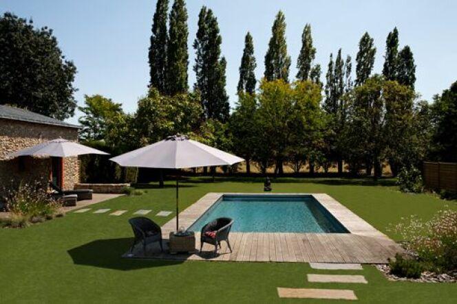 """Une piscine traditionnelle en béton, par Caron<span class=""""normal italic petit"""">© Caron</span>"""