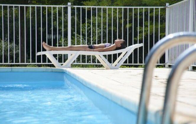 """Une barrière de protection de piscine<span class=""""normal italic petit"""">© Simon Coste - Fotolia.com</span>"""
